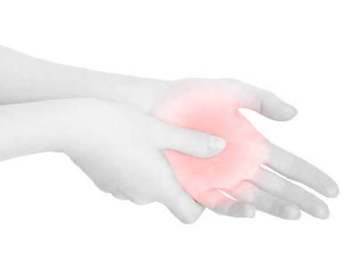 Woman hand touching with thumb the painful red palm isolated on